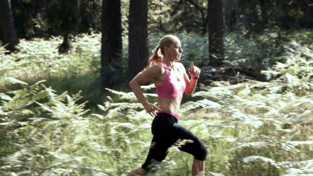 SLO MO DS Woman running in the forest