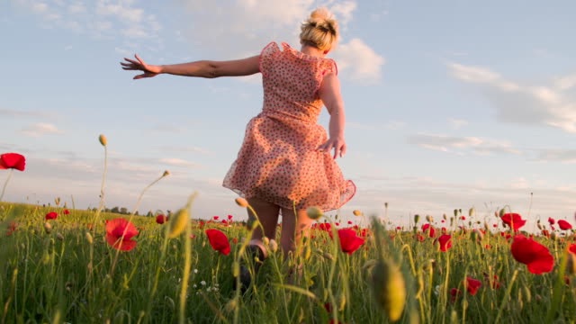 slo mo woman running in the meadow - sundress stock videos & royalty-free footage