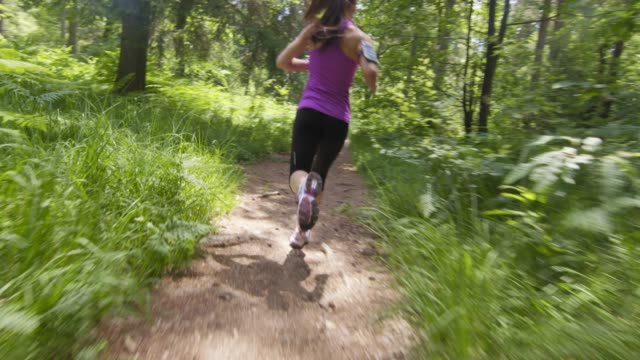SLO MO TS Woman running on a forest path