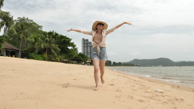 woman running on beach cheerful - full length stock videos & royalty-free footage