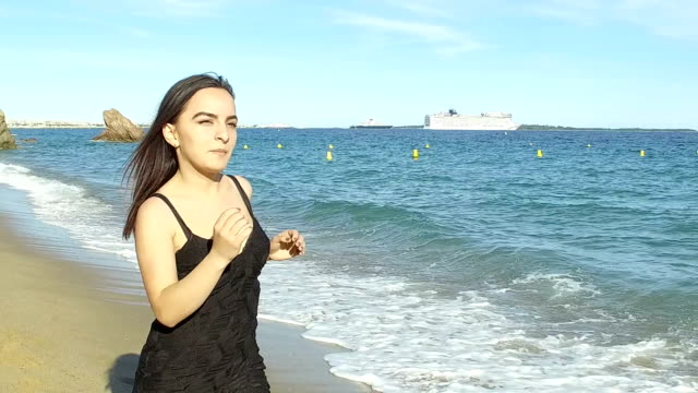 woman running on the beach. slow motion - black dress stock videos & royalty-free footage
