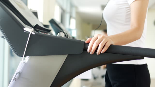 woman running on treadmill - clubhouse stock videos & royalty-free footage