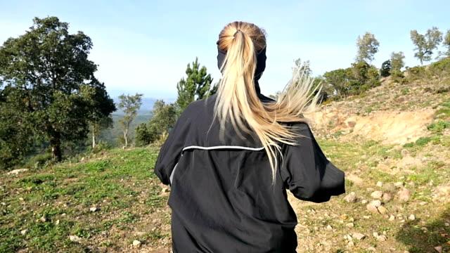 Woman running - rear view