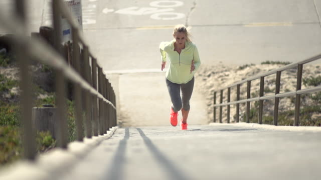 A woman running stairs. - Slow Motion - filmed at 240 fps