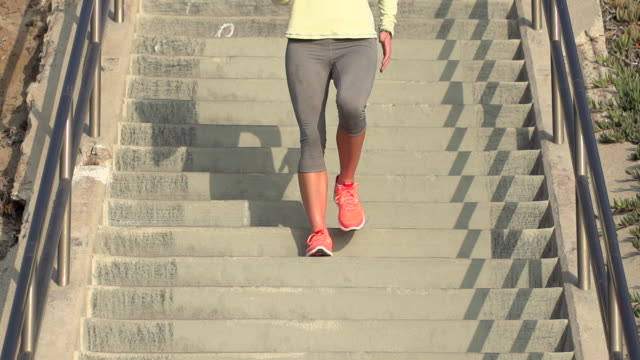 A woman running stairs.