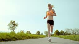 SLO MO TS Woman running through countryside