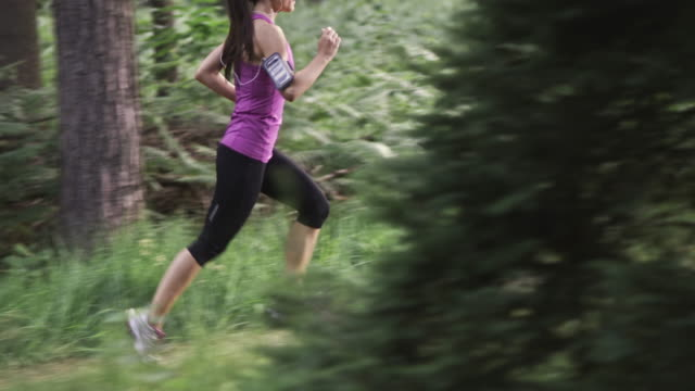 slo mo ds tu woman running through the forest - purple stock videos & royalty-free footage