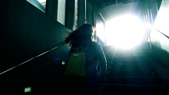 woman running to light - staircase stock videos and b-roll footage