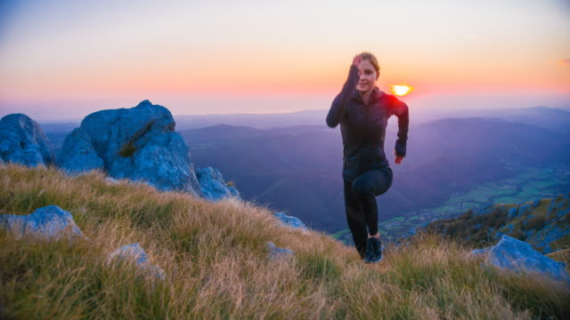 woman running uphill at sunrise - mountain range stock videos & royalty-free footage