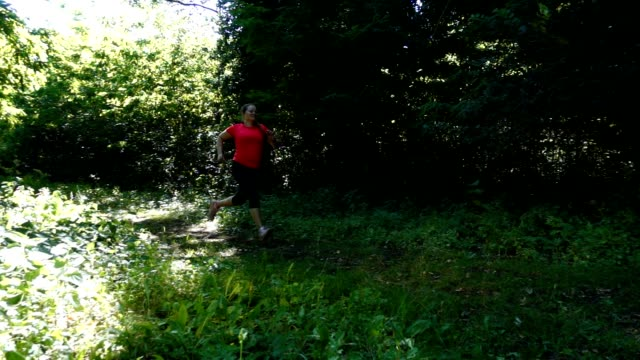 stockvideo's en b-roll-footage met woman running. - one mid adult woman only