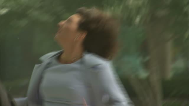 vidéos et rushes de a woman runs to safety during a storm. - tempête
