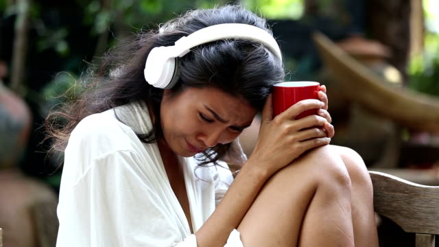 woman sad unhappy girl in big headphones listening music  broken heart love concept - part of stock videos & royalty-free footage