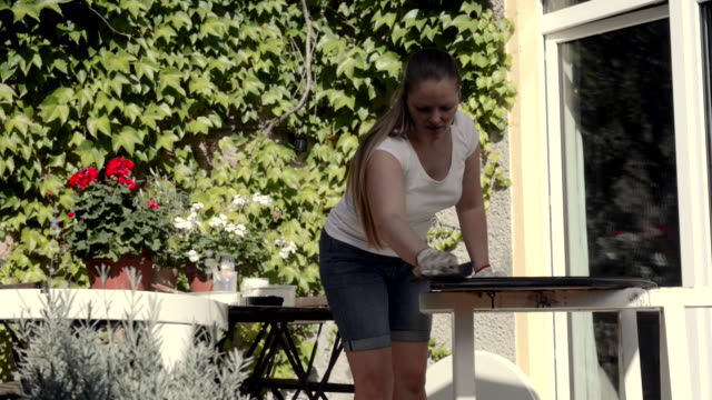 woman sanding old table outdoor. - only mid adult women stock videos and b-roll footage