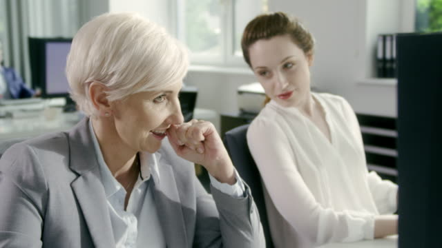 Woman satisfied with her work. Corporate business