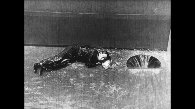 1922 woman (virginia fox) saves man (buster keaton) from drowning in automated pool - neck stock videos & royalty-free footage