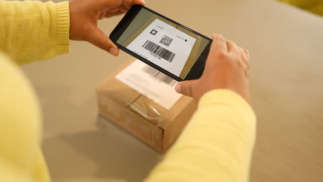 woman scanning package qr code - achievement stock videos & royalty-free footage