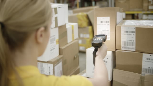 woman scanning packages in the warehouse - postal worker stock videos & royalty-free footage