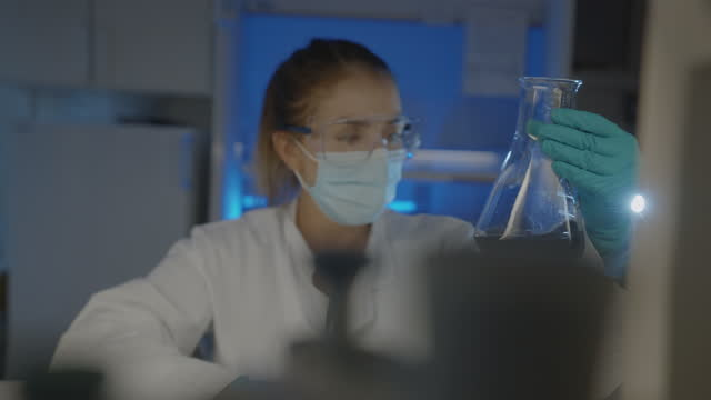 woman scientist researcher at work in laboratory - laboratory equipment stock videos & royalty-free footage