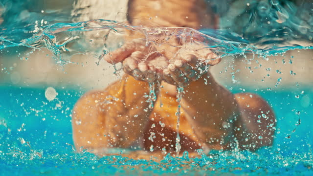 time warp woman scooping water with hands - poolside stock videos & royalty-free footage