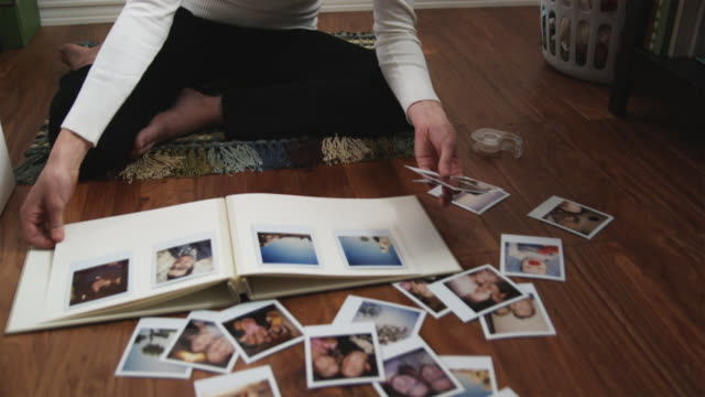 woman scrapbooking in her bedroom - photo album stock videos and b-roll footage