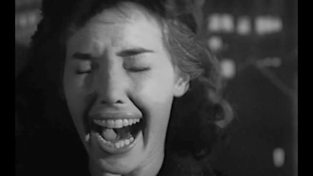 stockvideo's en b-roll-footage met 1959 cu of woman screaming hysterically with fear - gillen
