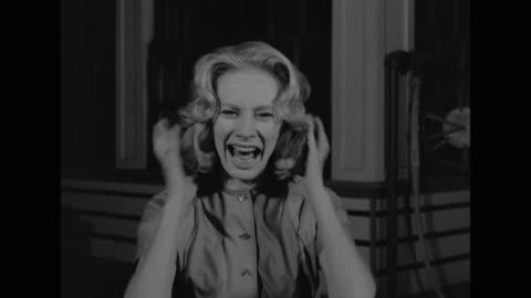 1962 a woman screams and runs away - archivmaterial stock-videos und b-roll-filmmaterial