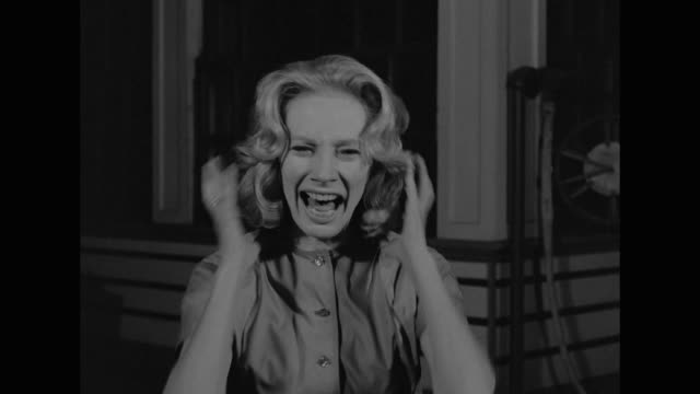 1962 a woman screams and runs away - angst stock-videos und b-roll-filmmaterial