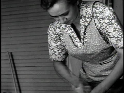 1940 cu woman (hazel parkinson) scrubbing laundry on washboard / united states - washtub stock videos and b-roll footage