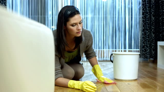 HD DOLLY: Woman Scrubbing The Floor