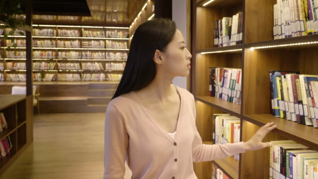 ds ms woman searching for book in library, beijing, china - straight hair stock videos & royalty-free footage