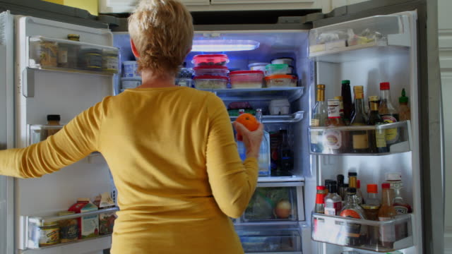 woman searching refridgerator for a snack - dieting stock videos & royalty-free footage