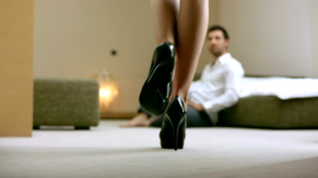 hd: woman seducing a man with handcuffs - flirting stock videos & royalty-free footage