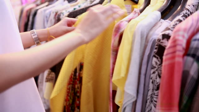 Woman selecting the clothes