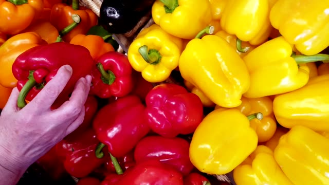 woman selecting vegetables in supermarket - red bell pepper stock videos & royalty-free footage