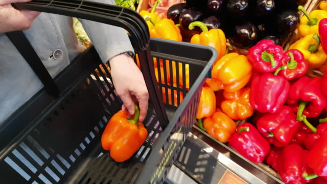 woman selecting vegetables in supermarket - shopping basket stock videos and b-roll footage