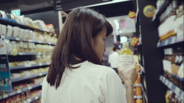 Woman selects product on the shelves in the store
