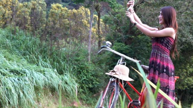 woman selfie near bicycle
