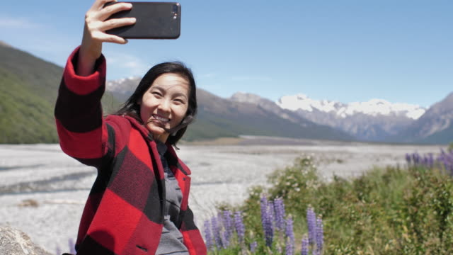 Woman selfie with mobile phone in New Zealand