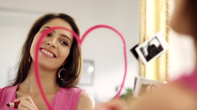 woman self-love. drawing lipstick heart on a mirror - self love stock videos & royalty-free footage