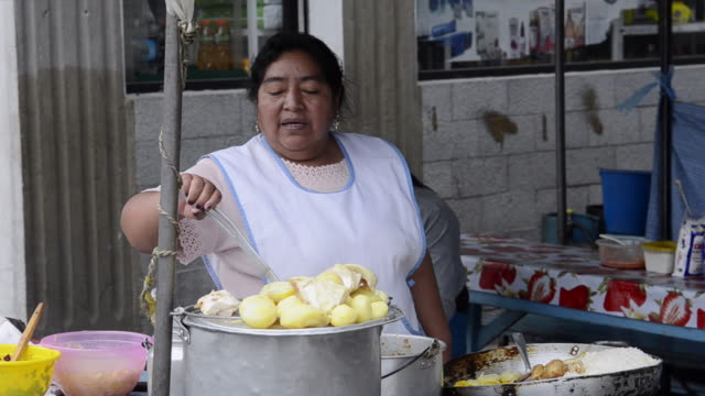ms woman selling and stirring soup on street in small village / otavalo, ecuador - only mid adult women stock videos and b-roll footage