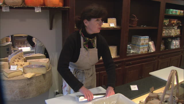ms woman selling cheese in delicatessen / beaune, burgundy, france - french culture stock videos & royalty-free footage