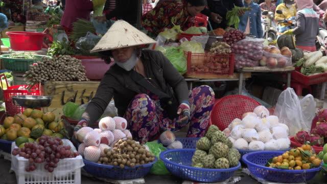 Woman selling fruits at street market