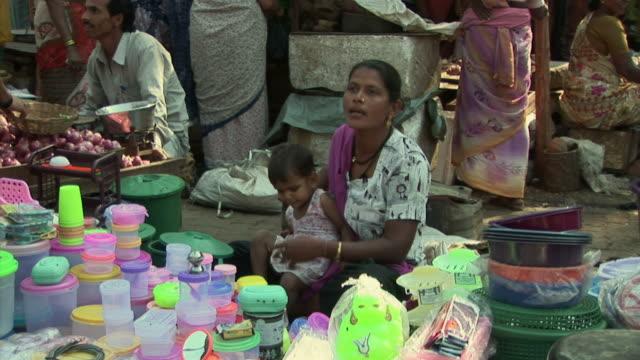 MS Woman selling plastic containers at street market / Dharavi, Mumbai, India