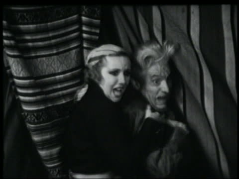 b/w 1935 woman + senior man near curtains scream in terror - 1935 stock videos & royalty-free footage