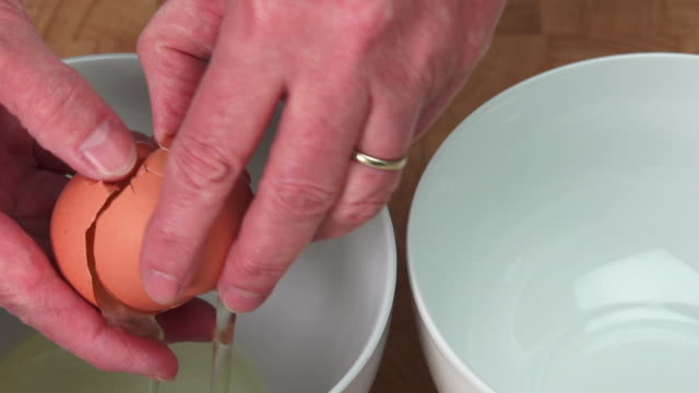 Woman Separating Organic Egg Close-up (4:2:2@100 Mb/s)