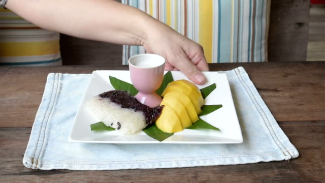 woman serve sticky rice with mango - ko samui stock videos and b-roll footage