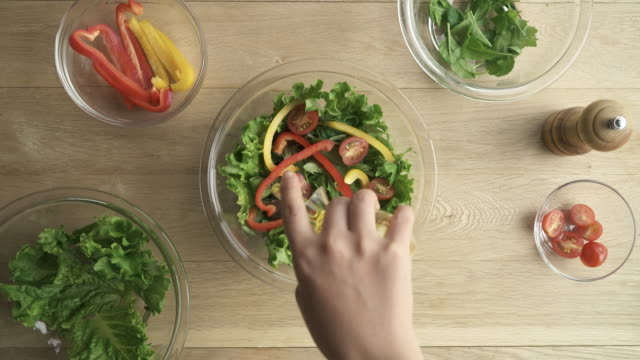 woman serve the salad in a bowl of glass - olive oil stock videos and b-roll footage