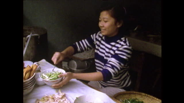woman serves pho ga soup from doorway in hanoi; 1989 - only mid adult women stock videos & royalty-free footage