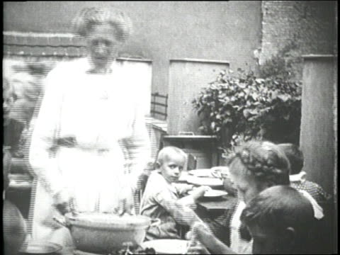 a woman serves soup to orphans - orphan stock videos & royalty-free footage