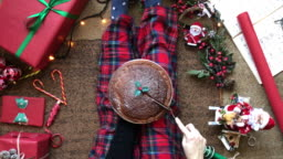 Woman serving Christmas Cake and Flat Lay